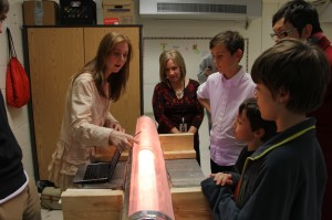 An N.C. State student demonstrates a plasma tube at Conn Elementary
