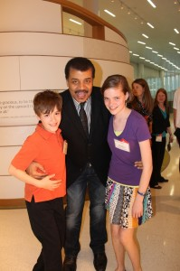 Hallie and Travis with Dr. Neil deGrasse Tyson