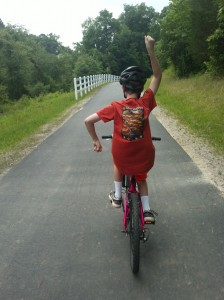 Travis hot-dogging on his red bike, June 2013.